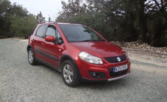 Car for sale in Paphos Cyprus : Orange Suzuki SX4 4X4