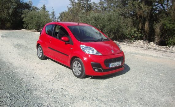 Car for sale in Paphos Cyprus : Red Peugeot 107